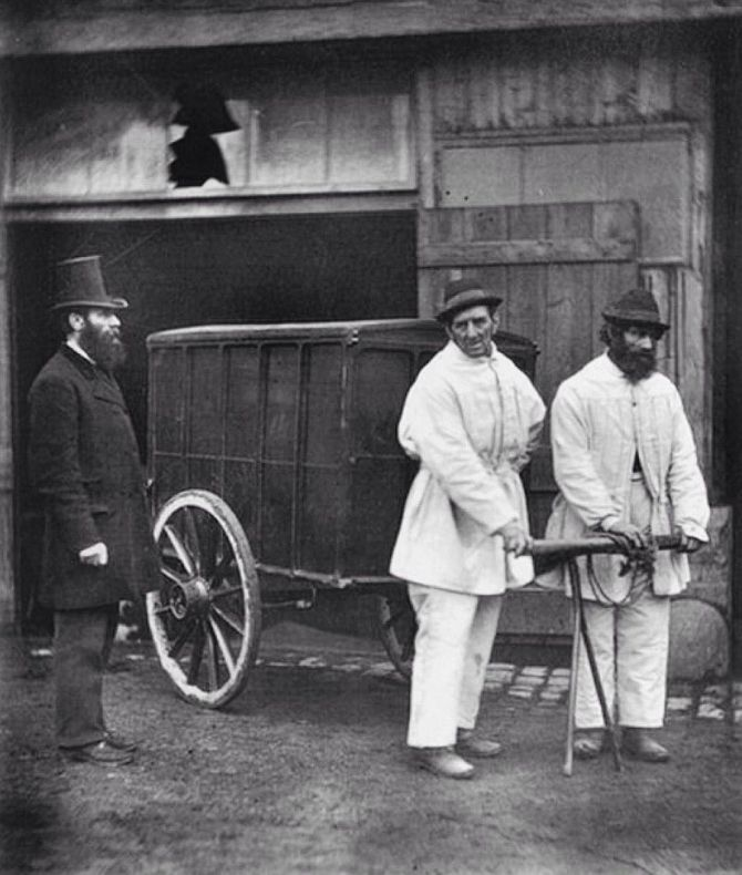 Image of disinfectors taking to London streets (1877)