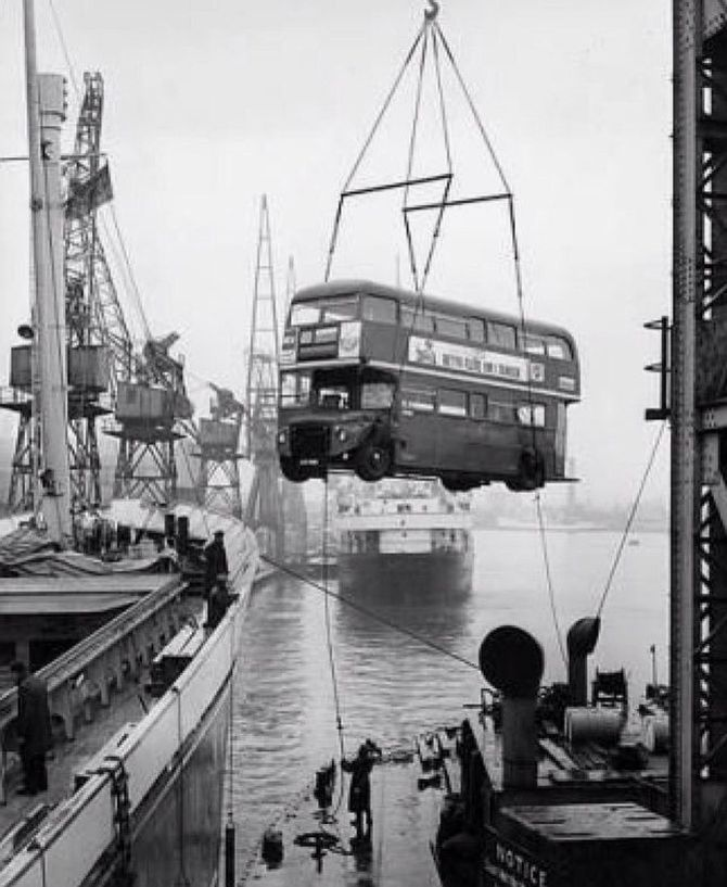 Image of A Routemaster bus as it is hoisted aboard a freighter bound for Sri Lanka